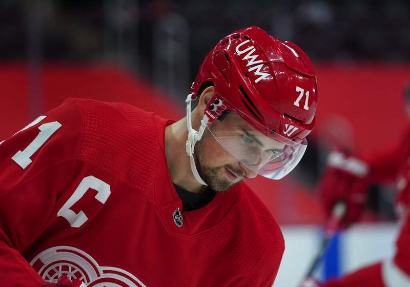 Detroit Red Wings center Dylan Larkin warms up before an NHL hockey game against the Carolina Hurricanes Thursday, Jan. 14, 2021, in Detroit. (AP Photo/Paul Sancya)