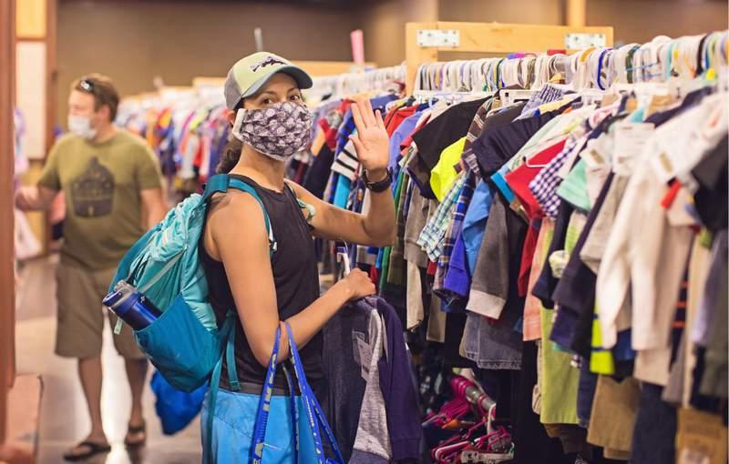 Parents shop the JBF Ann Arbor sale in face masks.