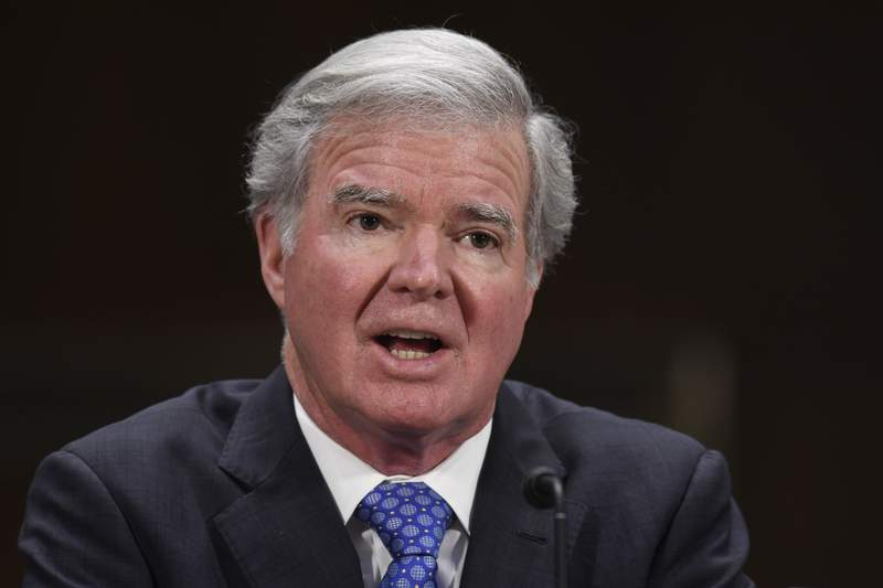 FILE - In this Feb. 11, 2020, file photo, NCAA President Mark Emmert testifies during a Senate Commerce subcommittee hearing on intercollegiate athlete compensation on Capitol Hill in Washington. Just days away from the start of the NCAA's most lucrative and high-profile event, the Division I men's basketball tournament, Emmert spoke to the AP about where things stand with the association's attempts to reform its rules related to name, image and likeness compensation for athletes. (AP Photo/Susan Walsh, File)