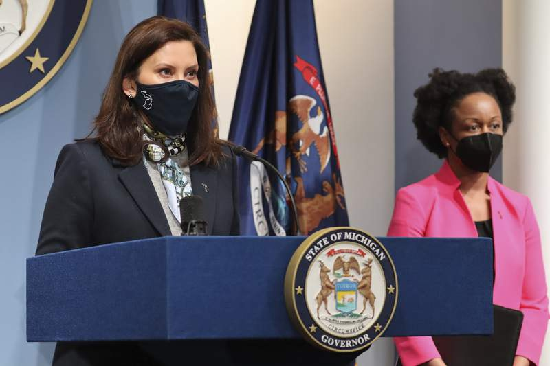 In a photo provided by the Michigan Office of the Governor, Michigan Gov. Gretchen Whitmer addresses the state during a speech, Wednesday, April 14, 2021, in Lansing, Mich. The governor provided an update on COVID-19 cases, vaccines and variants and discussed the state's efforts to expand the use of monoclonal antibody therapy to help those diagnosed with COVID-19 avoid hospitalization. (Michigan Office of the Governor via AP)