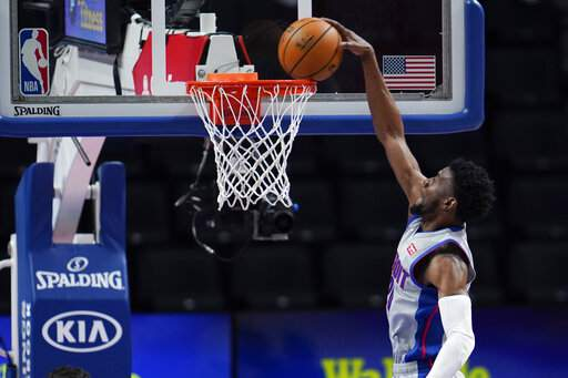 Detroit Pistons guard Josh Jackson (20) dunks against the Washington Wizards in the first half of a NBA basketball game in Detroit, Thursday, April 1, 2021. (AP Photo/Paul Sancya)