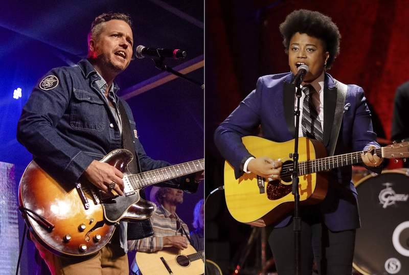 Jason Isbell performs at the To Nashville, With Love Benefit Concert in Nashville, Tenn. on March 9, 2020, left, and Amythyst Kiah of Our Native Daughters performs during the Americana Honors & Awards show in Nashville, Tenn. on Sept. 11, 2019. Singer-songwriters Isbell and  Kiah are both up for three nominations at this year's Americana Honors and Awards Show. This year's show will resume in-person on September 22 after the ceremony was cancelled last year due to the pandemic. (AP Photo)