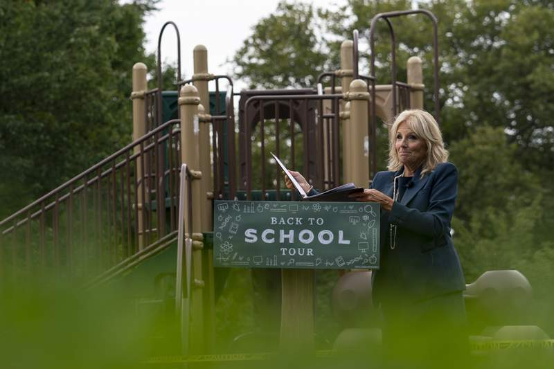 FILE - In this Sept. 1, 2020, file photo Jill Biden, wife of Democratic presidential candidate former Vice President Joe Biden, walks from a podium in front of a closed playground during a tour of the Evan G. Shortlidge Academy in Wilmington, Del. In an election year where reopening schools shuttered by the coronavirus pandemic is emerging as a flashpoint, Jill Biden is increasingly drawing on her experience in the classroom to empathize with parents struggling to cope with the shift to virtual learning. (AP Photo/Carolyn Kaster, File)