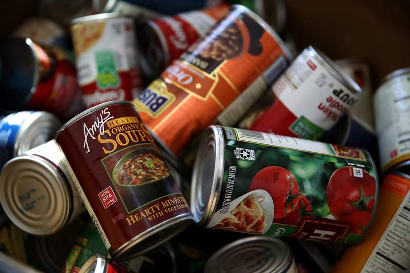 SAN MATEO, CA - NOVEMBER 29:  Donated canned foods sit in a bin at San Mateo High School on November 29, 2017 in San Mateo, California. San Mateo High School students are counting thousands of cans of food and donated packaged food items for their annual food drive. The students are hoping to surpass 100,000 pounds of food.  (Photo by Justin Sullivan/Getty Images)