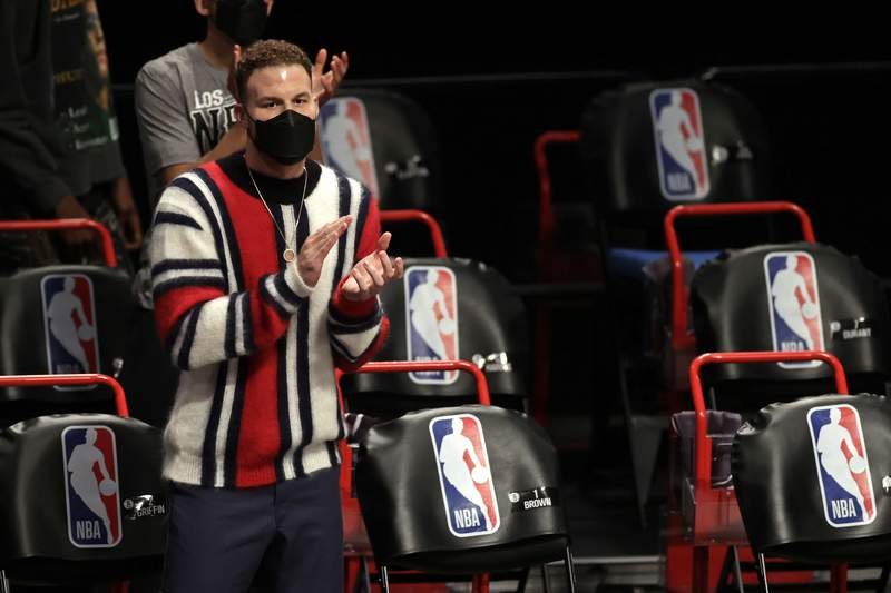 Brooklyn Nets Blake Griffin cheers on his team against the Boston Celtics during the first half of an NBA basketball game, Thursday, March 11, 2021, in New York. (AP Photo/Adam Hunger)