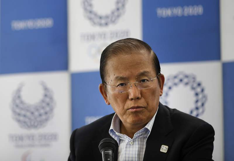 In this June 11, 2019, file photo, Toshiro Muto, CEO of the 2020 Tokyo Olympics organizing committee, listens to questions from the media during a news conference in Tokyo. Tokyo CEO Muto and other Olympic officials are proposing that the government relax immigration regulations, allowing athletes to enter the country before next years postponed games and train during a 14-day quarantine period. (AP Photo/Jae C. Hong, File)