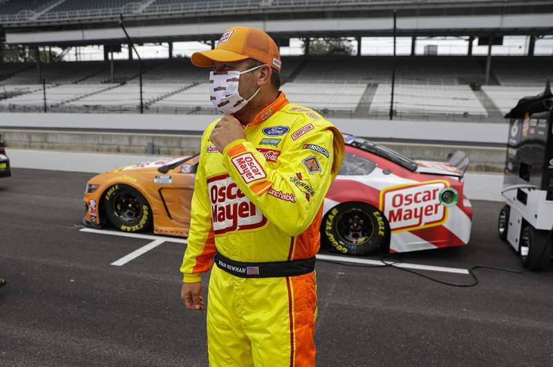 Ryan Newman waits in the pit area before a NASCAR Cup Series auto race at Indianapolis Motor Speedway in Indianapolis, Sunday, July 5, 2020. (AP Photo/Darron Cummings)