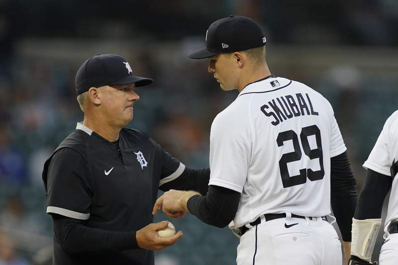 Detroit Tigers manager A.J. Hinch takes the ball from starting pitcher Tarik Skubal during the sixth inning of a baseball game against the Baltimore Orioles, Friday, July 30, 2021, in Detroit.