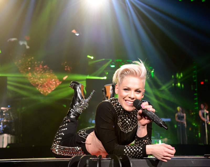 """Pink performs during """"The Truth About Love"""" tour opener in 2013 in Phoenix, Arizona."""