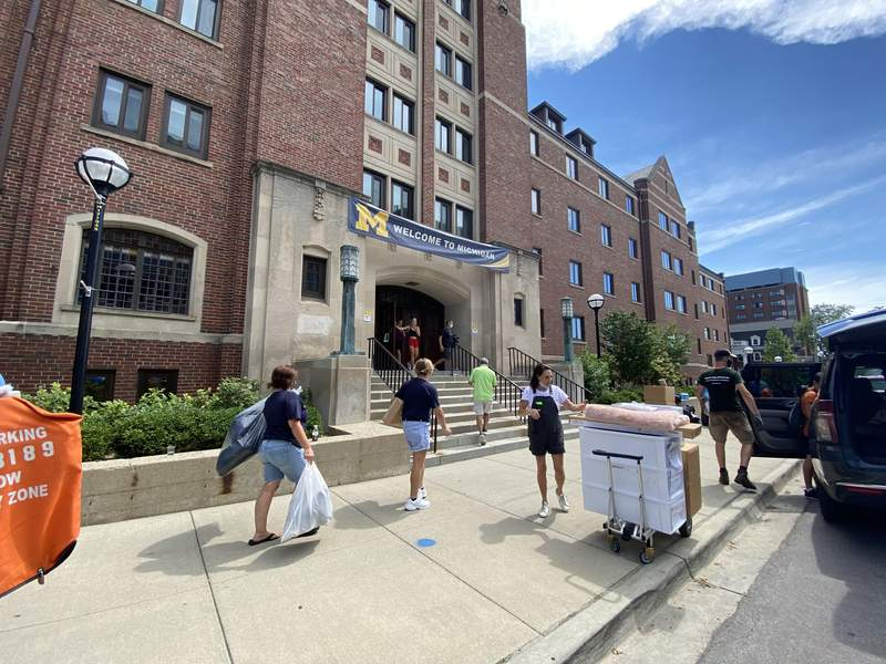 Students and their families move into West Quad on University of Michigan's Ann Arbor campus on Aug. 25, 2021.