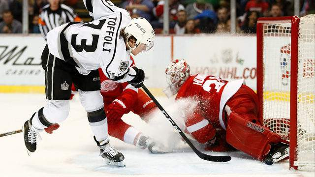 Tyler Toffoli of the Los Angeles Kings scores a third period goal between Danny DeKeyser and Jimmy Howard of the Detroit Red Wings to score a third period goal at Joe Louis Arena on December 15, 2016 in Detroit.  (Photo by Gregory Shamus/Getty Images)