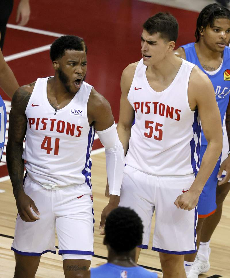 LAS VEGAS, NEVADA - AUGUST 08:  Saddiq Bey #41 and Luka Garza #55 of the Detroit Pistons reacts after Bey made a shot against the Oklahoma City Thunder and was fouled during the 2021 NBA Summer League at the Thomas & Mack Center on August 8, 2021 in Las Vegas, Nevada. The Thunder defeated the Pistons 76-72. NOTE TO USER: User expressly acknowledges and agrees that, by downloading and or using this photograph, User is consenting to the terms and conditions of the Getty Images License Agreement.  (Photo by Ethan Miller/Getty Images)