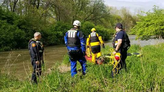Rochester Hills firefighters respond to a 9-1-1 call for a water rescue on the Clinton River on May 19, 2020.