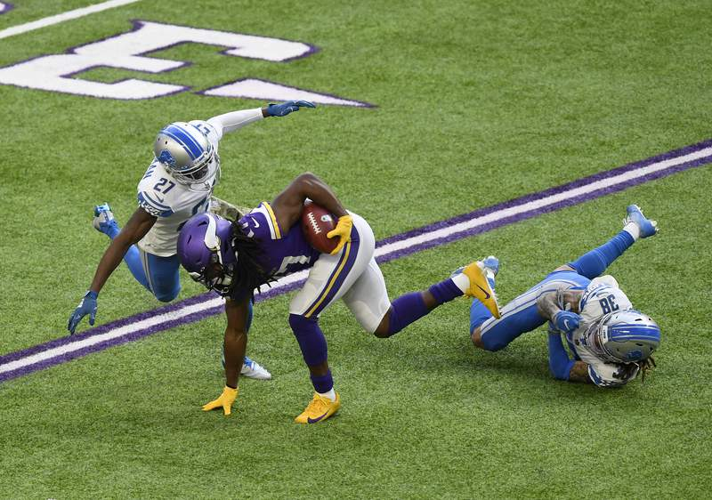 MINNEAPOLIS, MINNESOTA - NOVEMBER 08:  K.J. Osborn #17 of the Minnesota Vikings is covered by Justin Coleman #27 and Mike Ford #38 of the Detroit Lions at U.S. Bank Stadium on November 08, 2020 in Minneapolis, Minnesota. (Photo by Hannah Foslien/Getty Images)