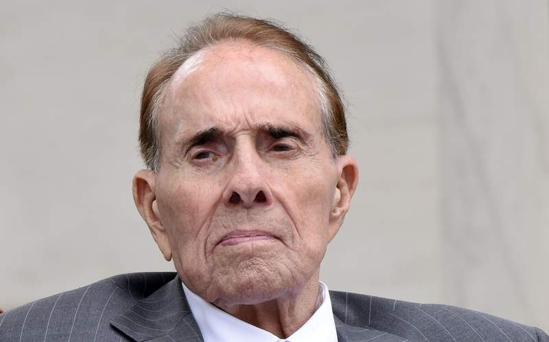 ARLINGTON, VA - MAY 29: Former Sen. Bob Dole attends a wreath-laying ceremony at the Tomb of the Unknown Soldier at Arlington National Cemetery on Memorial Day, May 29, 2017 in Arlington, Virginia. (Photo by Olivier Douliery - Pool/Getty Images)