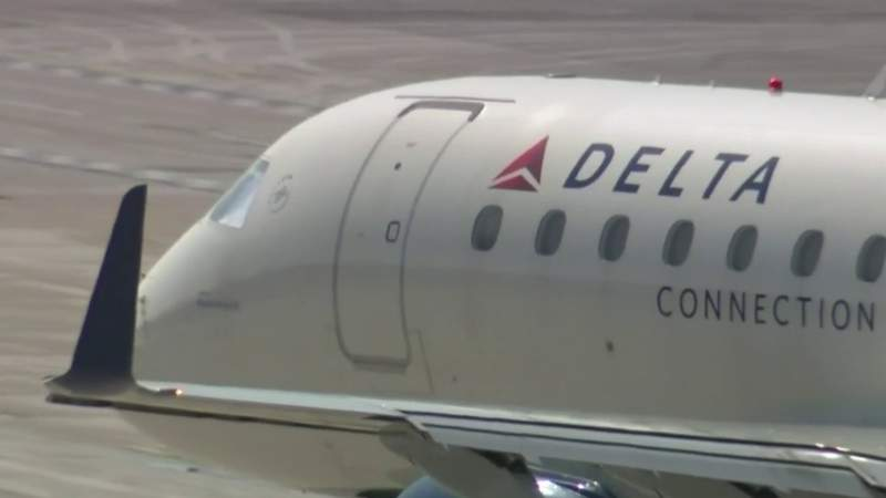 Cancellations due to staff shortages force Delta to open up middle seats
