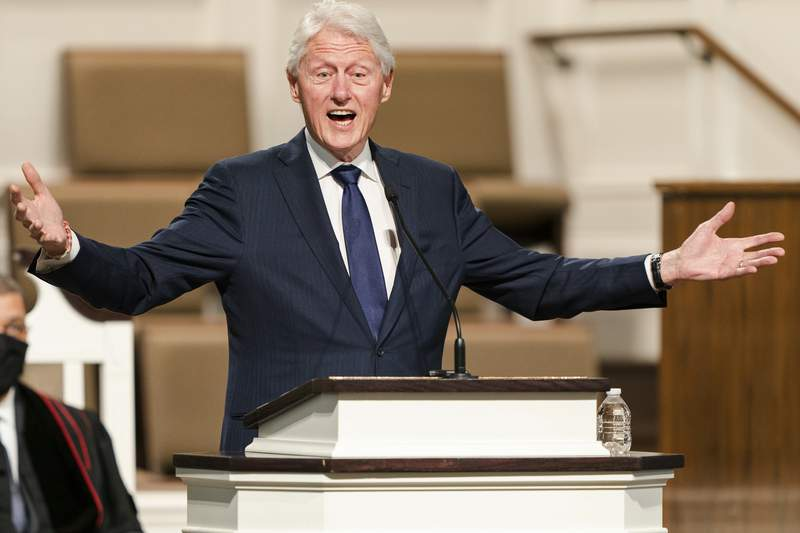 """FILE - In this Jan. 27, 2021, file photo, former President Bill Clinton speaks during funeral services for Henry """"Hank"""" Aaron, at Friendship Baptist Church in Atlanta. (Kevin D. Liles/Atlanta Braves via AP, Pool, File)"""