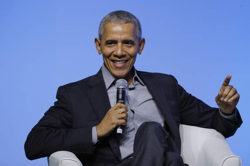 """FILE - Former U.S. President Barack Obama gesture as he attends the """"values-based leadership"""" during a plenary session of the Gathering of Rising Leaders in the Asia Pacific, organized by the Obama Foundation in Kuala Lumpur, Malaysia, on Dec. 13, 2019. Obamas memoir Dreams from My Father will be released in a young adult edition on October 5. Obama had yet to hold any political office when Dreams from My Father was released in 1995.  (AP Photo/Vincent Thian, File)"""