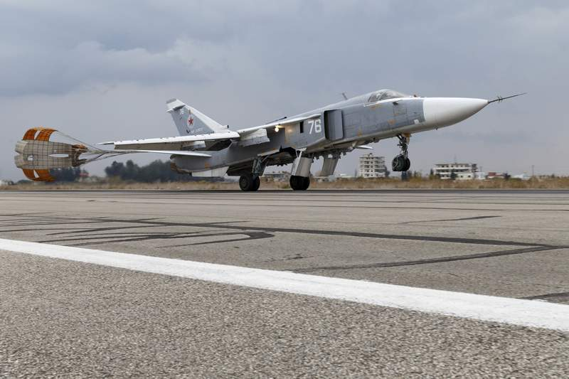 FILE - In this Wednesday, Dec. 16, 2015 file photo and provided by the Russian Defense Ministry Press Service, a Russian Su-24 bomber lands at Hemeimeem air base in Syria. The Russian military says its warship has fired warning shots and a warplane dropped bombs to force a British destroyer from Russia's waters near Crimea in the Black Sea. The incident on Wednesday June 23, 2021, marks the first time since the Cold War era when Moscow used live ammunition to deter a NATO warship, reflecting soaring Russia-West tensions. (Russian Defense Ministry Press Service via AP, File)