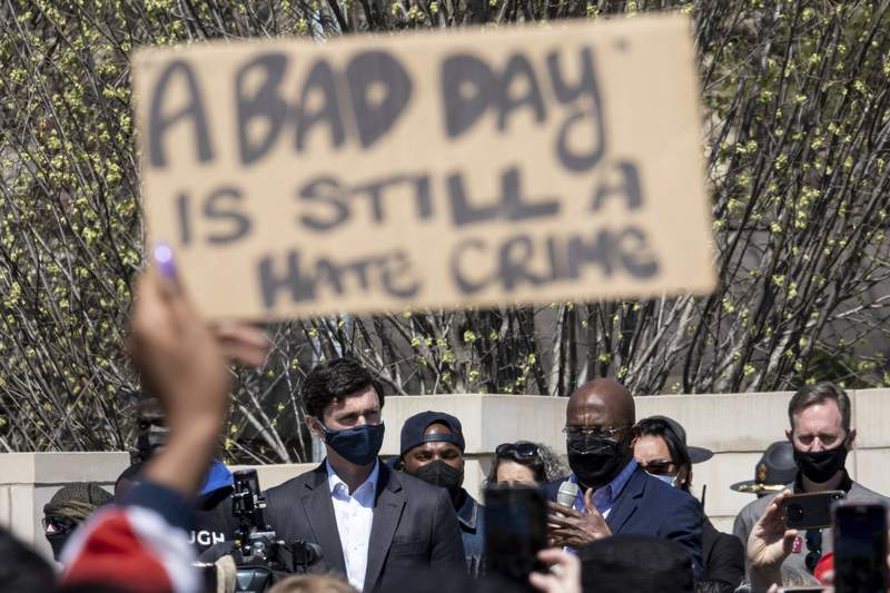 """U.S. Sens. Jon Ossoff, D-Ga., and Raphael Warnock, D-Ga., speak during a """"stop Asian hate"""" rally outside the Georgia State Capitol in Atlanta on Saturday afternoon, March 20, 2021. (AP Photo/Ben Gray)"""