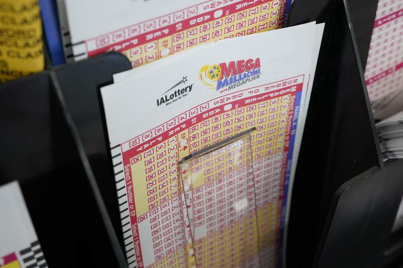 Blank forms for the Mega Millions lottery sit in a bin at a local grocery store, Tuesday, Jan. 12, 2021, in Des Moines, Iowa. Lottery players have a chance to win the largest jackpots in nearly two years as Tuesday's Mega Millions has grown to an estimated $625 million and Wednesday's Powerball to an estimated $550 million. (AP Photo/Charlie Neibergall)