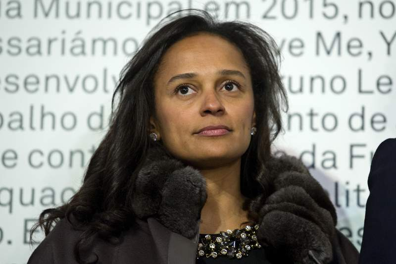 In this March 5, 2015 photo, Isabel dos Santos, reputedly Africa's richest woman, attends the opening of an art exhibition featuring works from the collection of her husband and art collector Sindika Dokolo in Porto, Portugal. On Monday, Jan. 6, 2020, Angola's foreign minister Manuel Augusto said that there is no political motivation behind the government's demand for more than $1 billion from dos Santos, her husband and a Portuguese business partner. Isabel dos Santos is a daughter of Jose Eduardo dos Santos, who ruled the oil- and diamond-rich nation for 38 years until 2017. (AP Photo/Paulo Duarte)