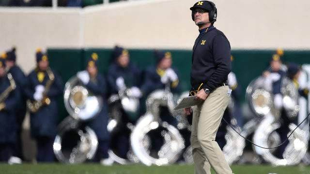 Jim Harbaugh of looks on during the first quarter against Michigan State at Spartan Stadium on Oct. 20, 2018, in East Lansing, Michigan. (Gregory Shamus/Getty Images)