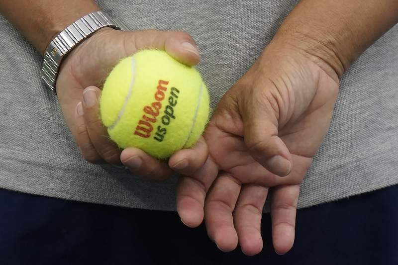 A ball person holds a US Open tennis ball during the third round of the U.S. Open tennis championships, Thursday, Sept. 3, 2020, in New York. (AP Photo/Frank Franklin II)