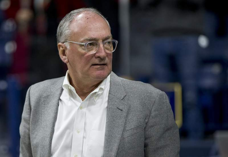fILE - In this Nov. 13, 2017, file photo, Notre Dame athletic director Jack Swarbrick attends an NCAA college basketball game between Notre Dame and Mount St. Mary's in South Bend, Ind. Swarbrick tells The Associated Press the school went public with its decision to not be included in EA Sports' new college football video game because the NCAA's proposed rule changes would prevent the names, images and likeness of players from being used in the game. (AP Photo/Robert Franklin, File)