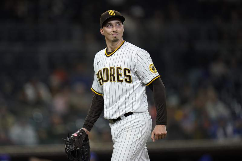 San Diego Padres starting pitcher Blake Snell walks toward the dugout after the top of the sixth inning of the team's baseball game against the New York Mets, Friday, June 4, 2021, in San Diego. (AP Photo/Gregory Bull)