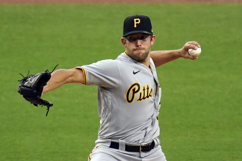 Pittsburgh Pirates starting pitcher Tyler Anderson works against a San Diego Padres batter during the first inning of a baseball game Monday, May 3, 2021, in San Diego. (AP Photo/Gregory Bull)