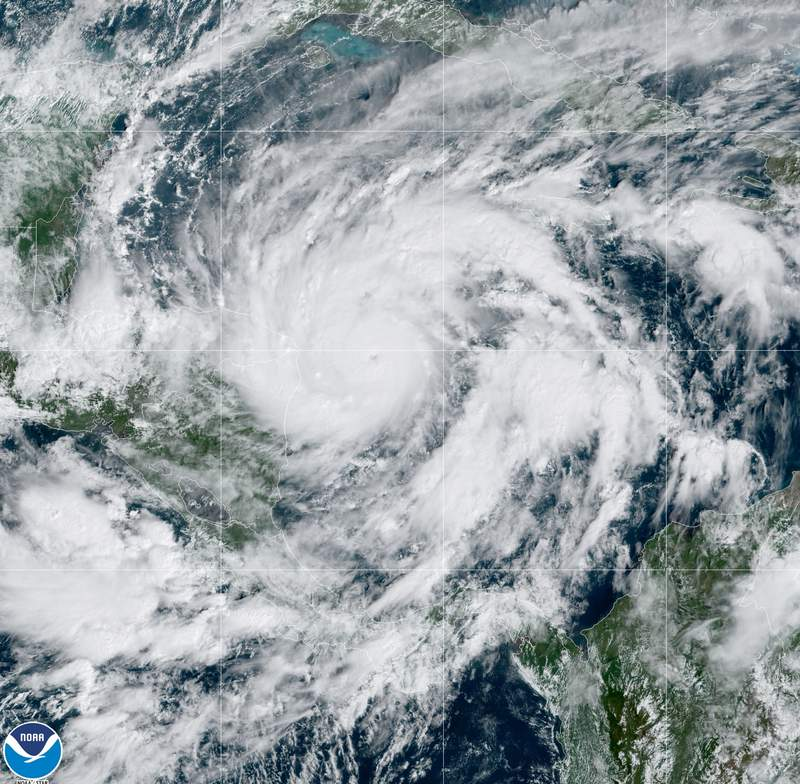 This GeoColor satellite image taken Monday, Nov. 2, 2020, at 1 p.m. EDT, and provided by NOAA, shows Hurricane Etna in the Gulf of Mexico approaching the border of Honduras and Nicaragua. New Hurricane Eta quickly gained force Monday as it headed for Central America on the verge of becoming a major hurricane, threatening massive flooding and landslides across a vulnerable region. (NOAA via AP)