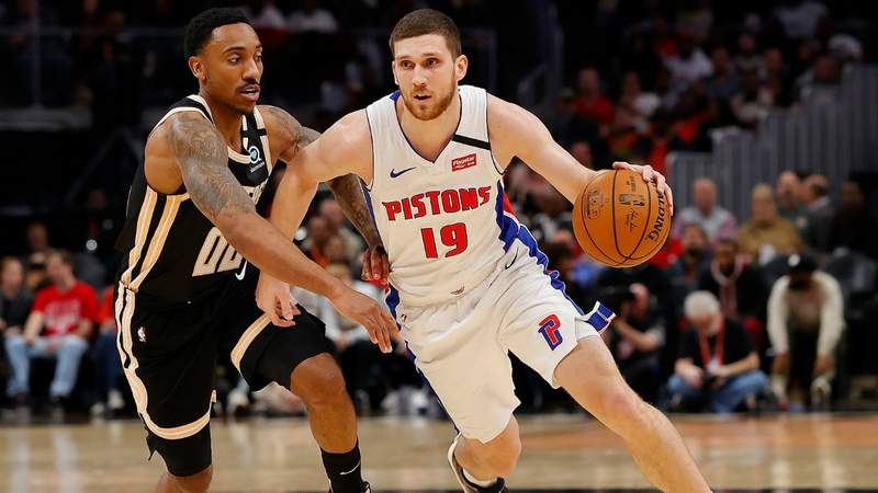 Sviatoslav Mykhailiuk #19 of the Detroit Pistons drives against Jeff Teague #00 of the Atlanta Hawks.(Photo by Kevin C. Cox/Getty Images)