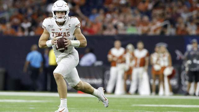 Sam Ehlinger #11 of the Texas Longhorns rolls out to pass in the third quarter against the Rice Owls at NRG Stadium on September 14, 2019 in Houston, Texas. (Photo by Tim Warner/Getty Images)