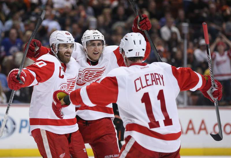 ANAHEIM, CA - MAY 12:  (L-R) Henrik Zetterberg #40, Valtteri Filppula #51 and Daniel Cleary #11 of the Detroit Red Wings celebrate Filppula's goal in the second period against the Anaheim Ducks in Game Seven of the Western Conference Quarterfinals during the 2013 NHL Stanley Cup Playoffs at Honda Center on May 12, 2013 in Anaheim, California.  (Photo by Jeff Gross/Getty Images)