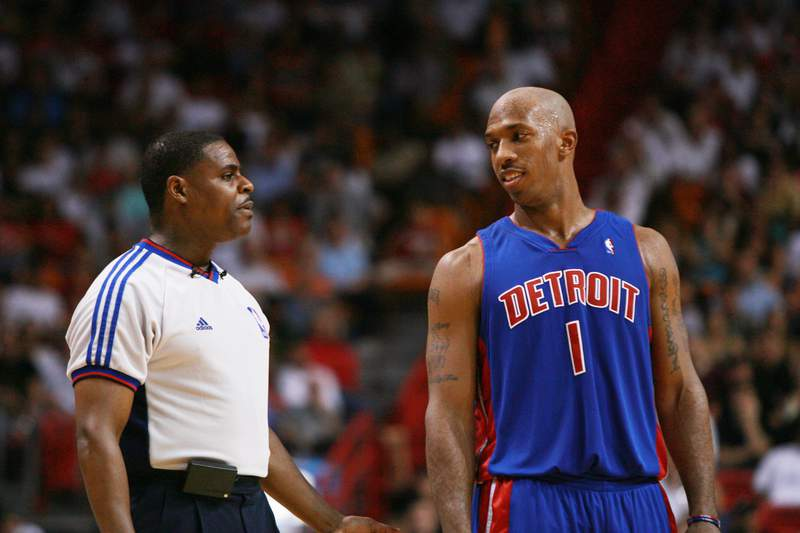 MIAMI - NOVEMBER 30:  Chauncey Billups #1 of the Detroit Pistons talks to referee Leroy Richardson during the game against the Miami Heat at American Airlines Arena on November 30, 2006 in Miami, Florida. The Pistons won 87-85. NOTE TO USER: User expressly acknowledges and agrees that, by downloading and or using this photograph, User is consenting to the terms and conditions of the Getty Images License Agreement. (Photo by Doug Benc/Getty Images)
