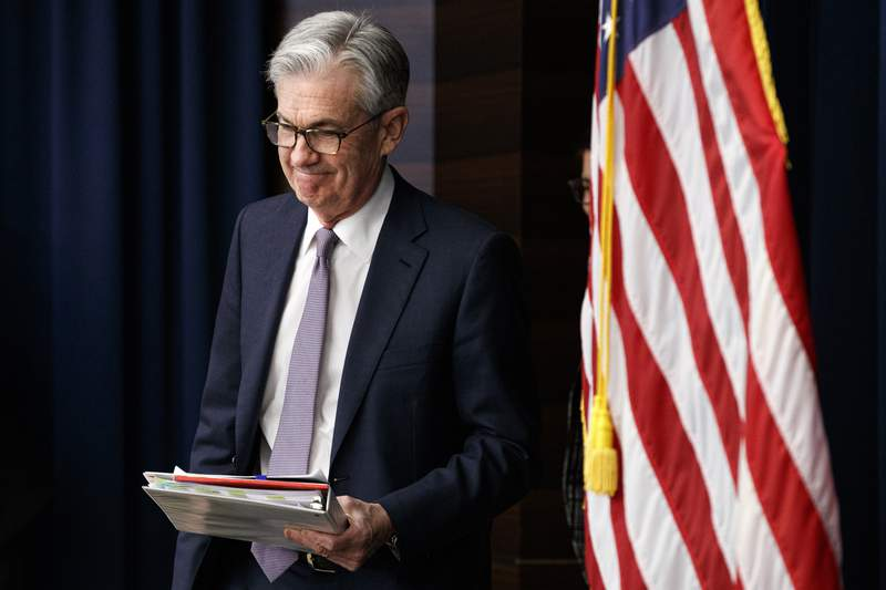 FILE - In this Dec. 11, 2019, file photo Federal Reserve Chair Jerome Powell arrives to speak at a news conference after the Federal Open Market Committee meeting in Washington. For the first time in years, Federal Reserve officials will hold their latest policy meeting this week feeling broadly satisfied with where interest rates are and with seemingly no inclination to change them anytime soon. Powell has expressed a sense of gratification with Fed policy. (AP Photo/Jacquelyn Martin, File)