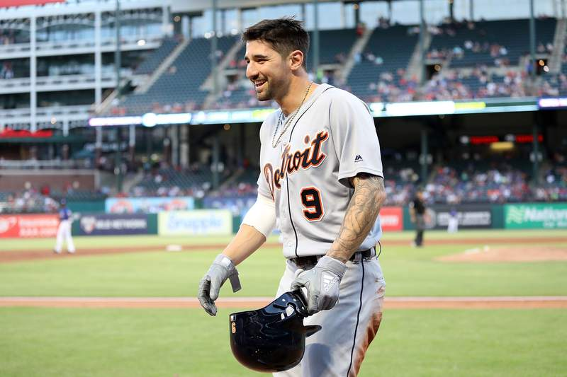 Nicholas Castellanos #9 of the Detroit Tigers smiles after scoring a run in the third inning against the Texas Rangers at Globe Life Park in Arlington on May 7, 2018 in Arlington, Texas.