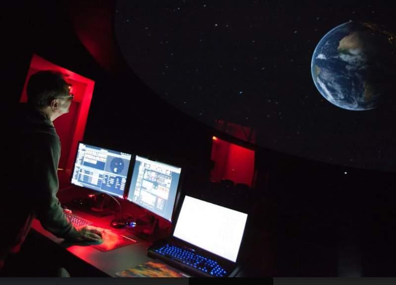 Matt Linke operates UMMNH's planetarium.