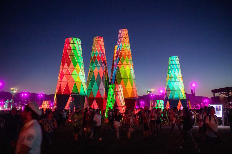 Festival-goers gather and walk around at the 2019 Coachella Valley Music And Arts Festival.