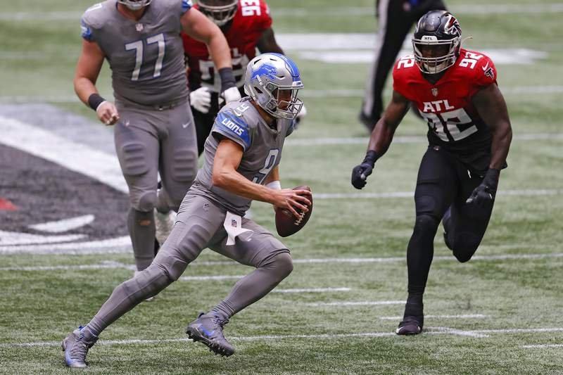 ATLANTA, GEORGIA - OCTOBER 25:  Matthew Stafford #9 of the Detroit Lions scrambles with the ball against the Atlanta Falcons during the second half at Mercedes-Benz Stadium on October 25, 2020 in Atlanta, Georgia. (Photo by Kevin C. Cox/Getty Images)