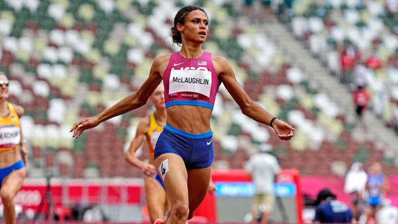 American Sydney McLaughlin downed her own world record, claiming the Olympic title in the 400-meter hurdles.