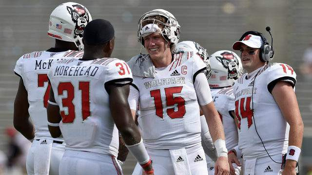 Ryan Finley #15 congratulates teammate Matthew McKay #7 of the North Carolina State Wolfpack after McKay's fourth quarter touchdown during their game against the Georgia State Panthers at Carter-Finley Stadium on September 8, 2018 in Raleigh, North Carolina. North Carolina Sate won 41-7. (Photo by Grant Halverson/Getty Images)