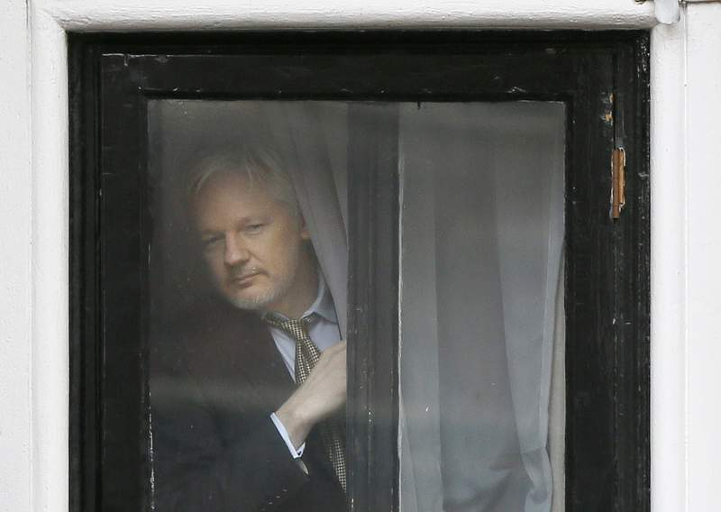 FILE - In this Friday, Feb. 5, 2016 file photo, Wikileaks founder Julian Assange appears at the window before speaking on the balcony of the Ecuadorean Embassy in London. A London court has heard that Julian Assanges conversations in the latter part of his seven-year stay at the Ecuadorian Embassy in London were systematically bugged, even in the toilet. Two anonymous witnesses who worked for a Spanish firm with a security contract at the embassy said the WikiLeaks founder faced an intensifying bugging operation after Donald Trump became U.S. president. (AP Photo/Kirsty Wigglesworth, File)