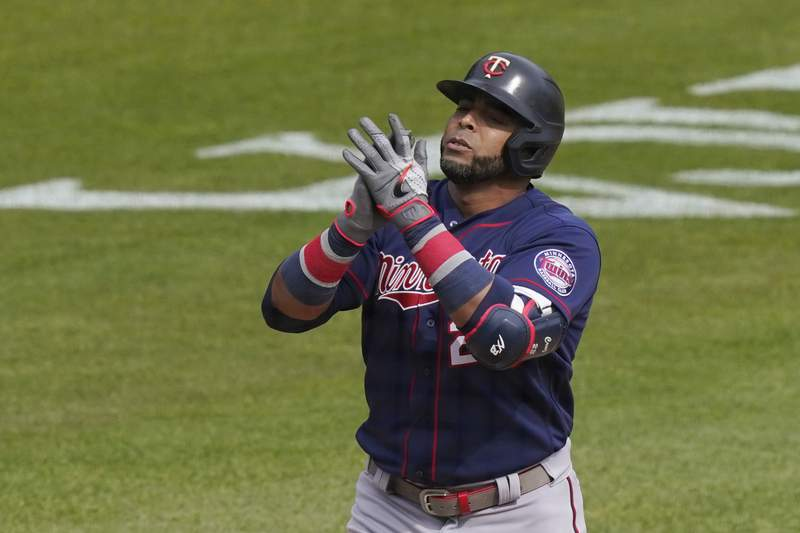 Minnesota Twins designated hitter Nelson Cruz reaches at home plate after a solo home run during the seventh inning of a baseball game against the Detroit Tigers, Tuesday, April 6, 2021, in Detroit. (AP Photo/Carlos Osorio)