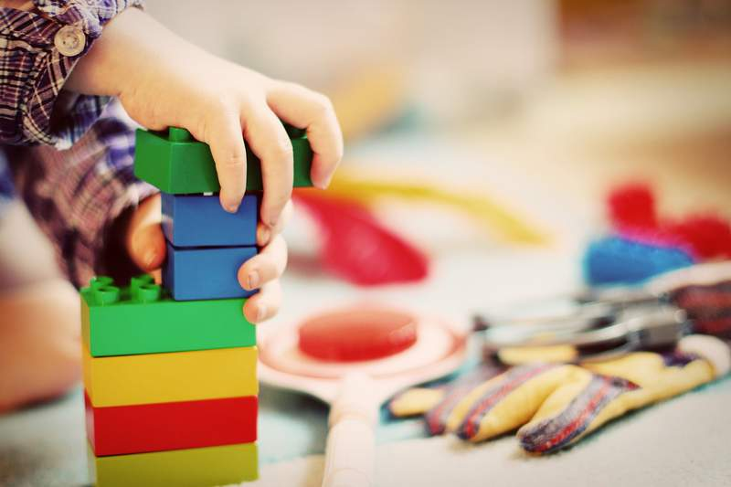 A child plays with building blocks.