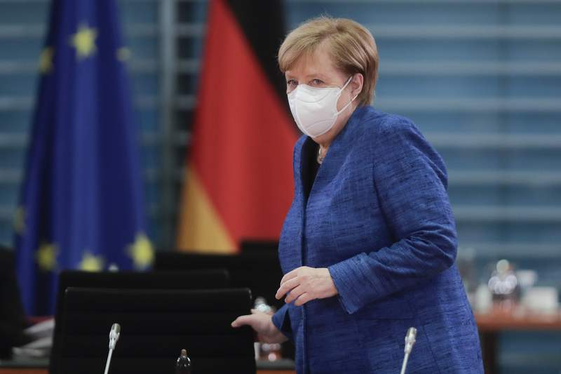 German Chancellor Angela Merkel arrives for the weekly cabinet meeting of the German government at the chancellery in Berlin, Wednesday, Oct. 21, 2020. (AP Photo/Markus Schreiber, Pool)