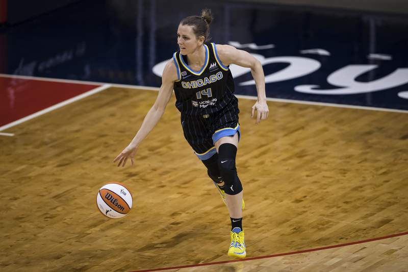 WASHINGTON, DC - MAY 15: Allie Quigley #14 of the Chicago Sky dribbles the ball against the Washington Mystics during the first half at Entertainment & Sports Arena on May 15, 2021 in Washington, DC. NOTE TO USER: User expressly acknowledges and agrees that, by downloading and or using this photograph, User is consenting to the terms and conditions of the Getty Images License Agreement. (Photo by Scott Taetsch/Getty Images)