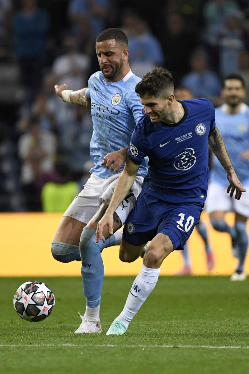 Manchester City's Kyle Walker, left, fights for the ball with Chelsea's Christian Pulisic during the Champions League final soccer match between Manchester City and Chelsea at the Dragao Stadium in Porto, Portugal, Saturday, May 29, 2021. (Pierre Philippe Marcou/Pool via AP)