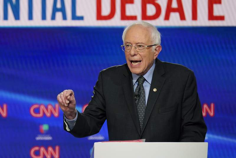 In this Sunday, March 15, 2020, photo, Sen. Bernie Sanders, I-Vt., with former Vice President Joe Biden, speaks during a Democratic presidential primary debate at CNN Studios in Washington. What might be the final showdown between the two very different Democratic candidates takes place Tuesday, March 17, 2020, during Florida's presidential primary. (AP Photo/Evan Vucci)